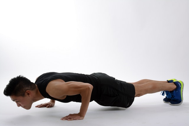 Pushup an exercise lying facing the floor and raising their body by pressing down with their hands.